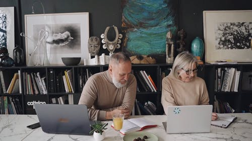 An Elderly Couple Working from Home