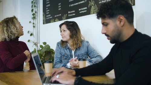 People Having a Business Meeting Inside a Café