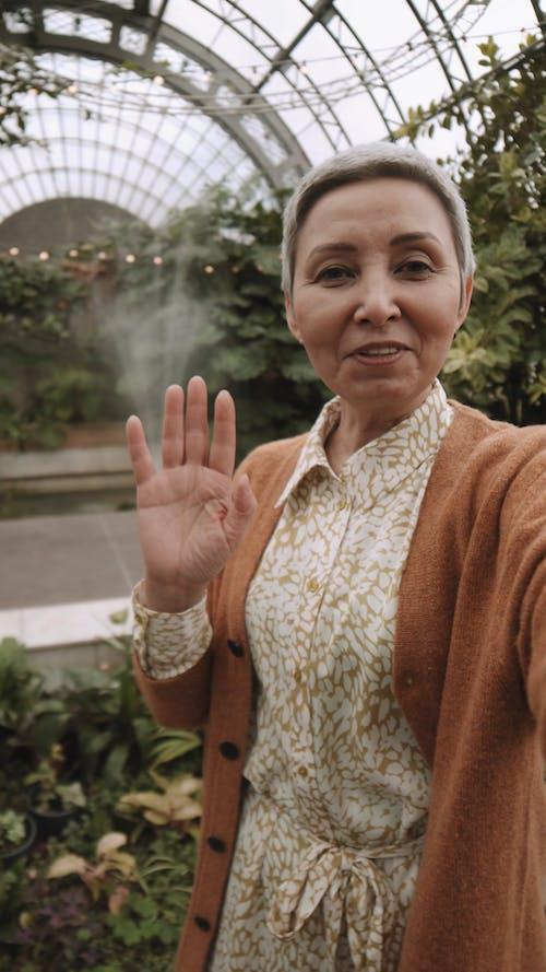 Woman Showing Her Botanical Garden