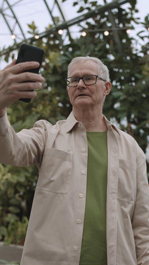 Man Taking Selfie Using His Smartphone