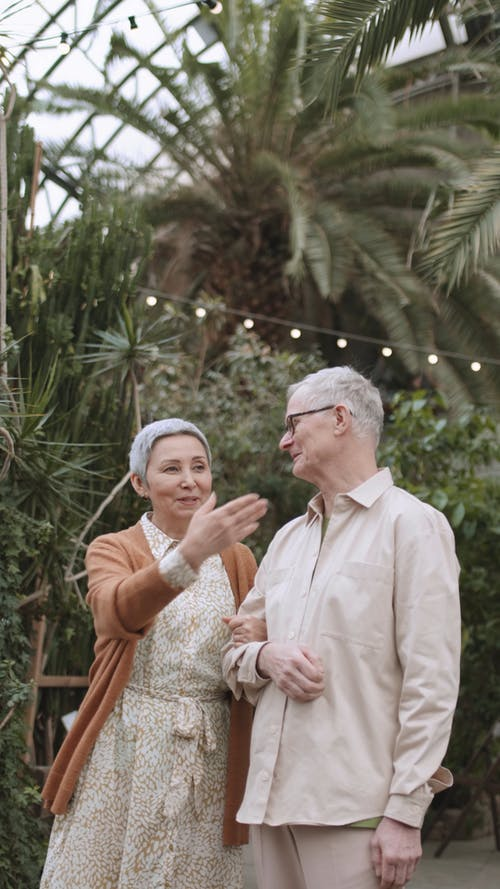 Couple Standing Outdoors While Talking to Each Other