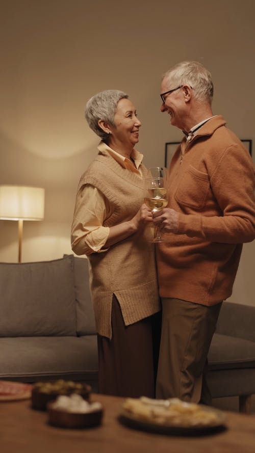 Couple Dancing While Holding Wine Glass With Wine