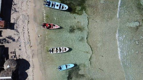 Small Boats on Sand Beach