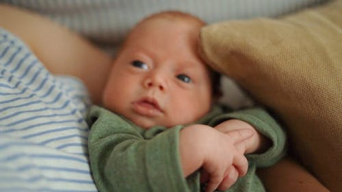 Baby on Arms of Parent