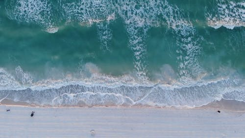 Aerial Footage of Sea Waves Rushing to the Shore