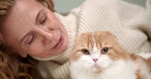 A Woman Petting Her Cat
