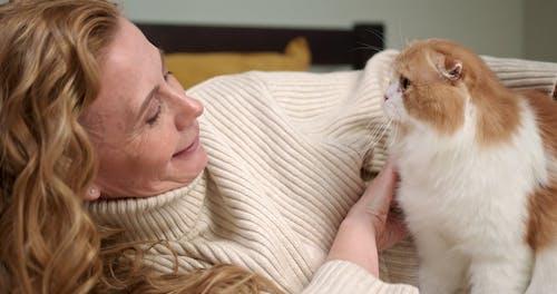 A Woman Cuddling Her Cat