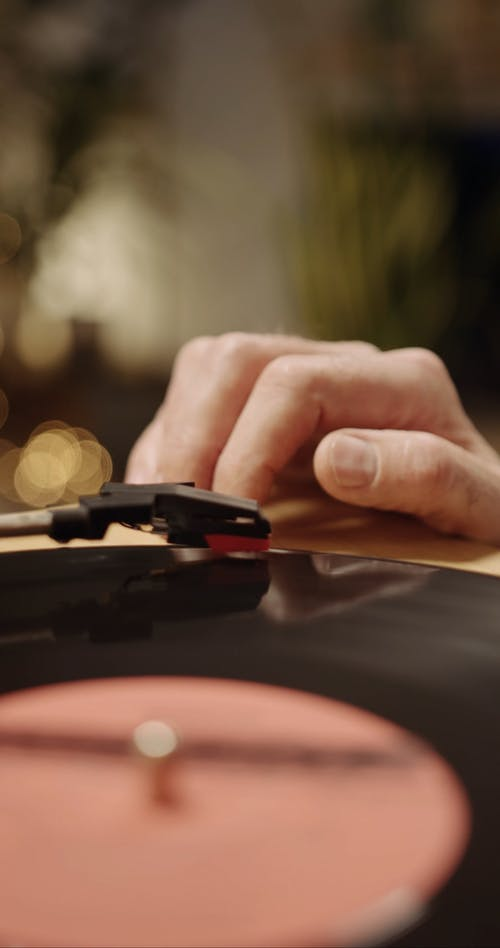 A Person Tapping Fingers on a Turntable
