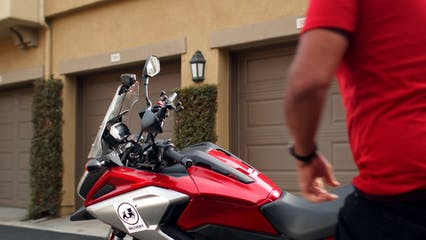 A Deliveryman Riding A Motorcycle