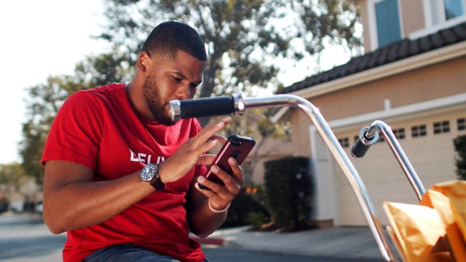 Man Checking Details Of Delivery On His Phone