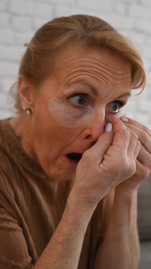 An Elderly Woman Wearing Eye Masks