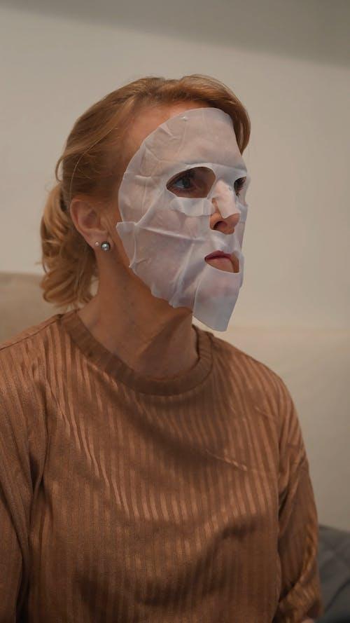 An Elderly Woman Wearing a Facial Mask