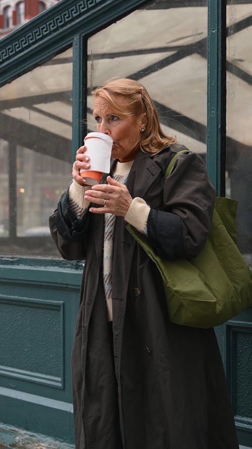 Elderly Woman Drinking Hot Coffee