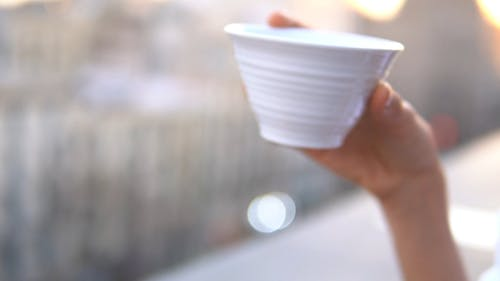 Woman Drinking in White Cup