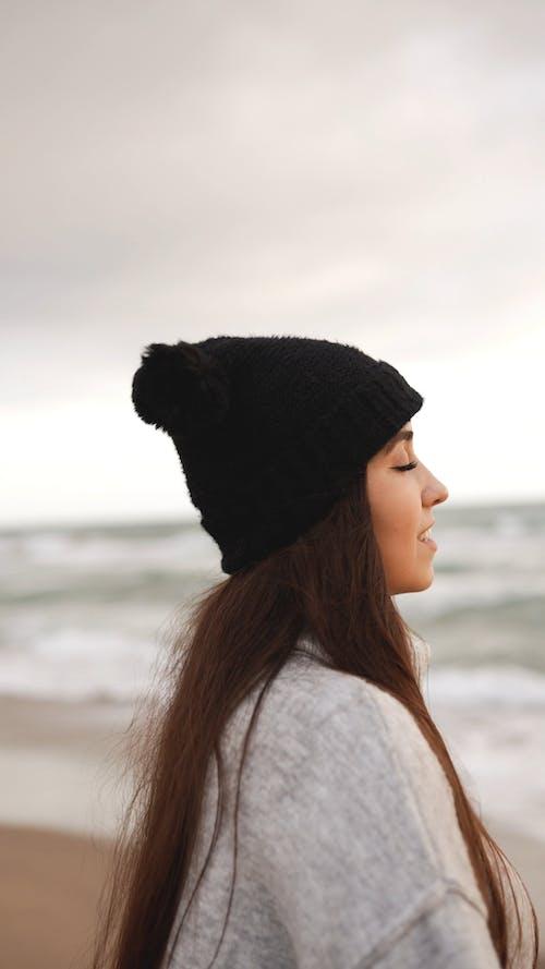 Woman Having Fun on the Shore