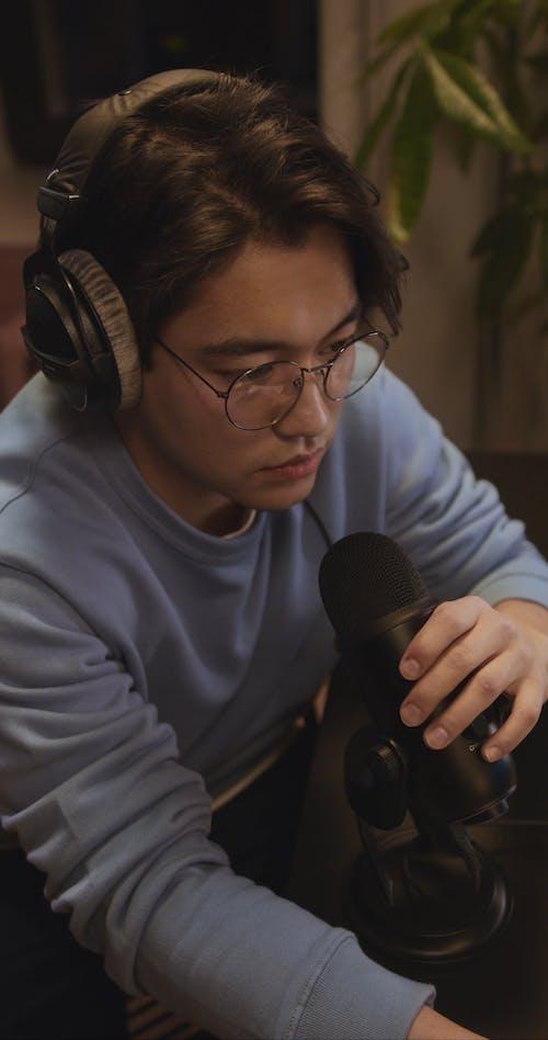 Man Recording an Audio