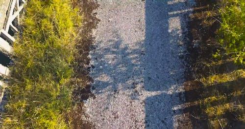 Drone Footage of a Broken Bridge over the River