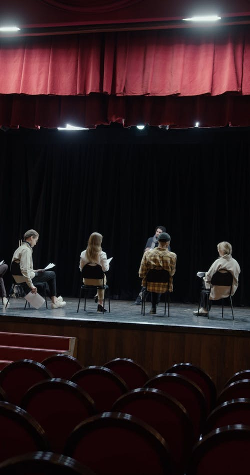 A Stage Director Meeting With His Casts