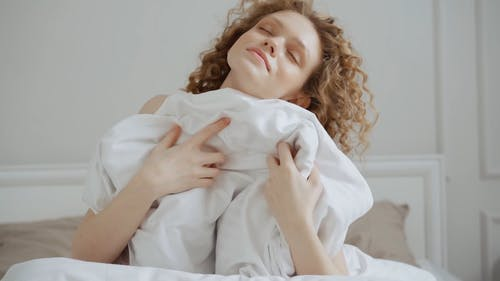 A Woman Sitting on the Bed
