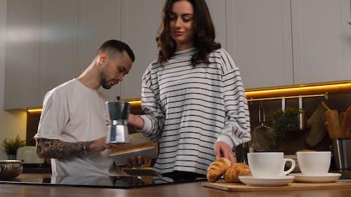 Woman Pouring Coffee on the Mug