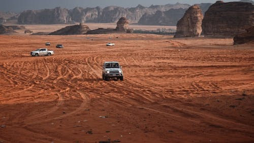 A Car Moving Uphill on a Desert