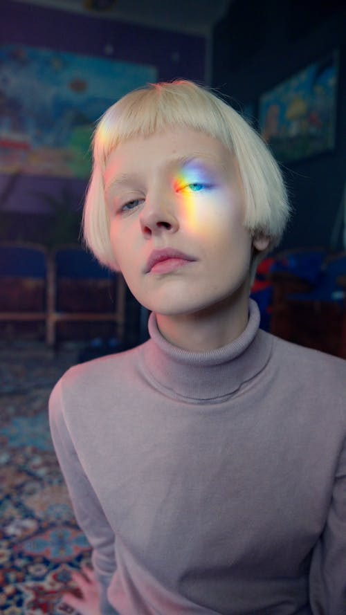 A Woman with Rainbow Light on Her Face