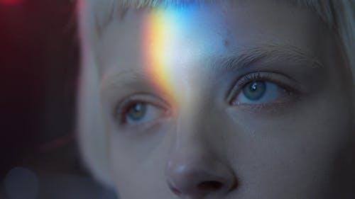 Rainbow Light Shining On a Woman's Face