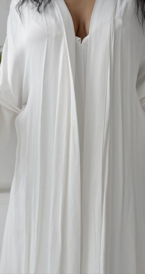 Female Body in White Robe