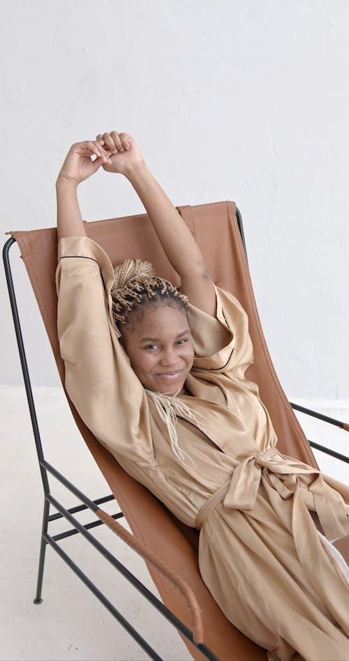 Woman Sitting on Chair Wearing Silk Robe