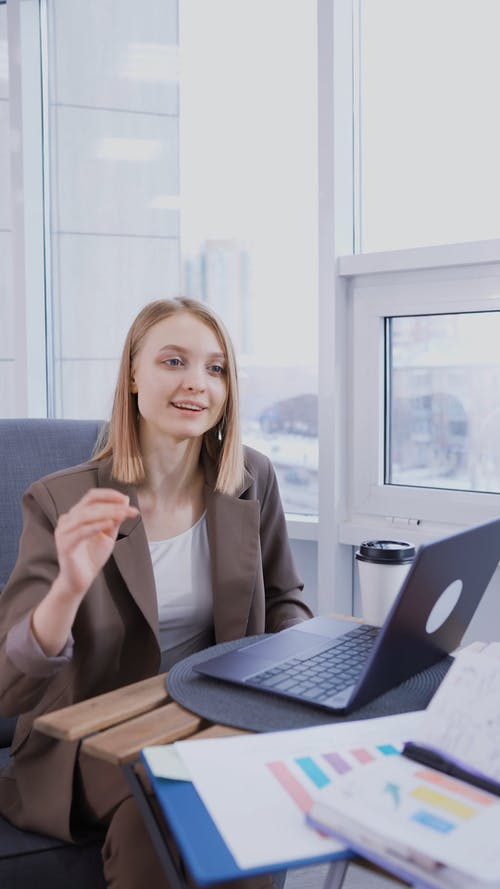 Woman Drinking Coffee at the Meeting