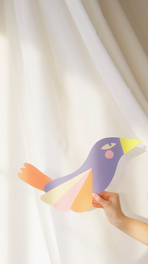A Painted Paper Cutout Of A Bird