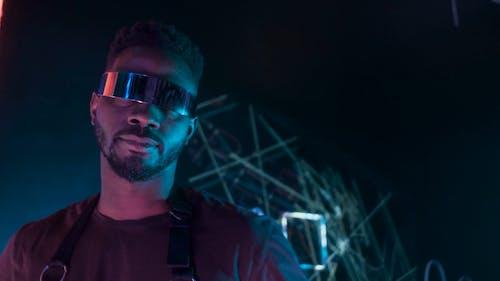 A Man with Futuristic Sunglasses