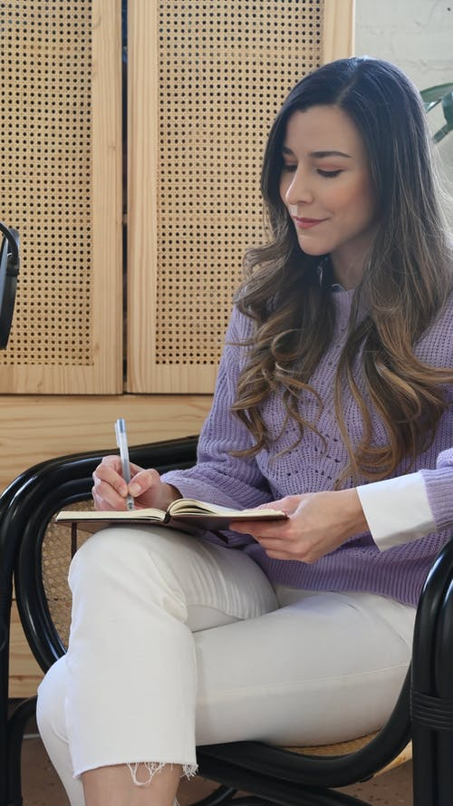A Person Taking Notes During and Interview