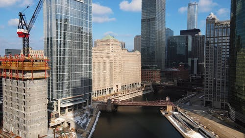 An Aerial Footage of a City with High-rise Buildings