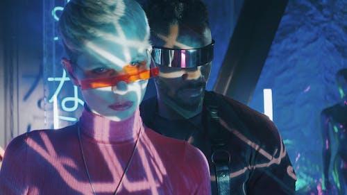 A Stylish Man and Woman Wearing Sunglasses