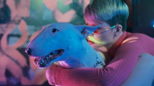 A Woman Hugging a Bull Terrier