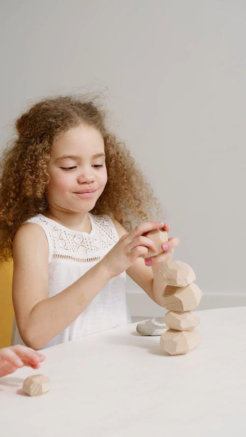 A Little Girl Stocking Wooden Block