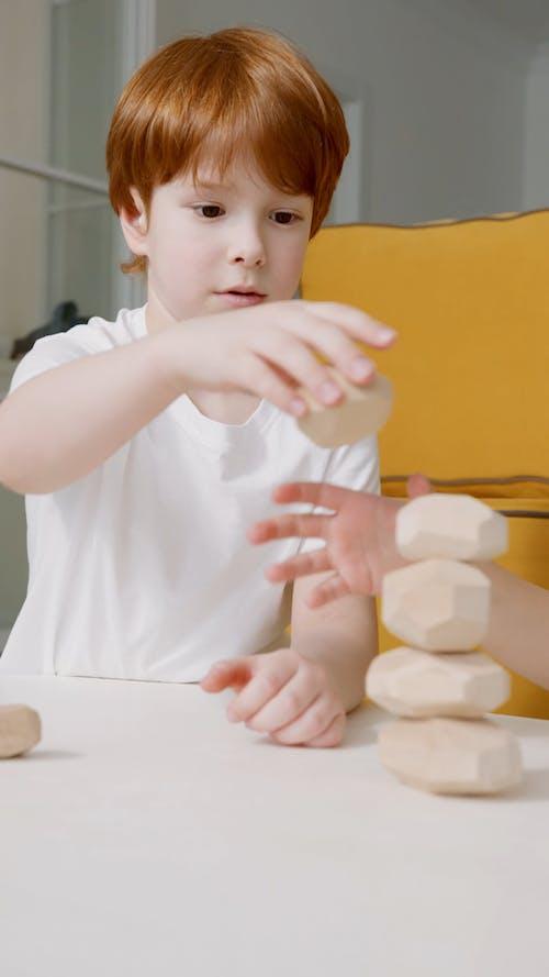 A Little Boy Stocking Wooden Block