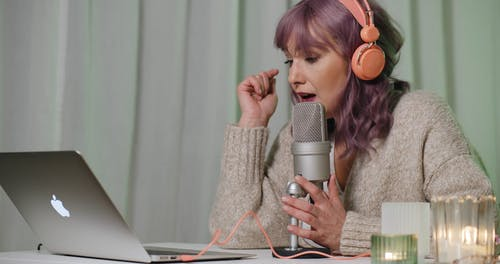 A Woman Recording Audio Podcast