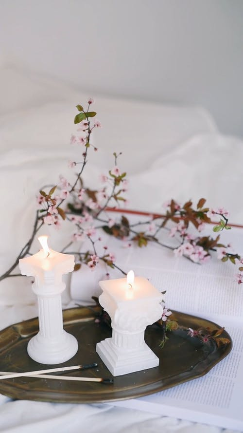 Lighted Candles on a White Blanket
