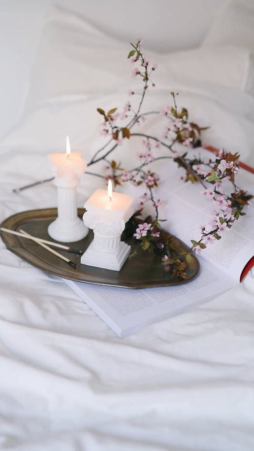 Lighted Candles on Bed