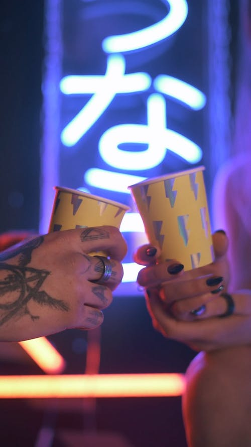 People Holding paper Cups