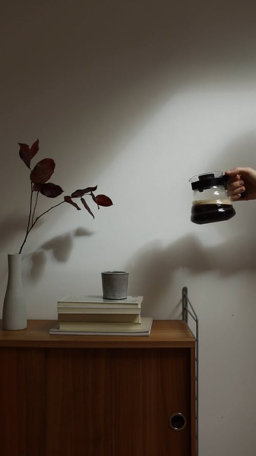 Pouring Coffee on Ceramic Cup