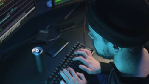 A Man Typing on the Keyboard