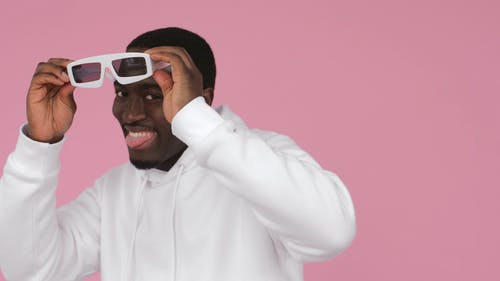 Man Dancing with Tongue Out While Wearing Sunglasses