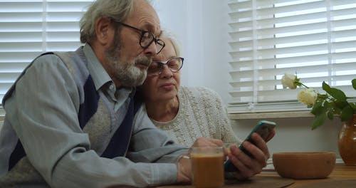 Elderly Couple Using a Smartphone