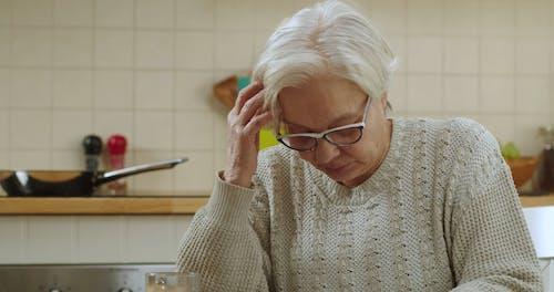 Elderly Couple Reading a Bad News