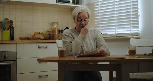 Elderly Couple Reading Bad News