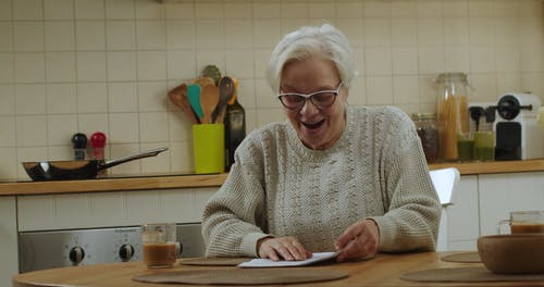 Elderly Couple Reading Good News