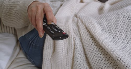 Close-Up Video of a Person Holding a Remote Controller